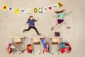 School kids chasing in class room
